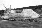 The partly completed Masonry Dam. The coffer dam is flooded. c.1897.